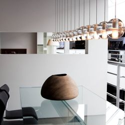 14 Series Chandelier by Bocci; Simplicity Table by Santambrogio; Wood Bowl by Ernst Gamperl; Papilio Chairs by B&B Italia