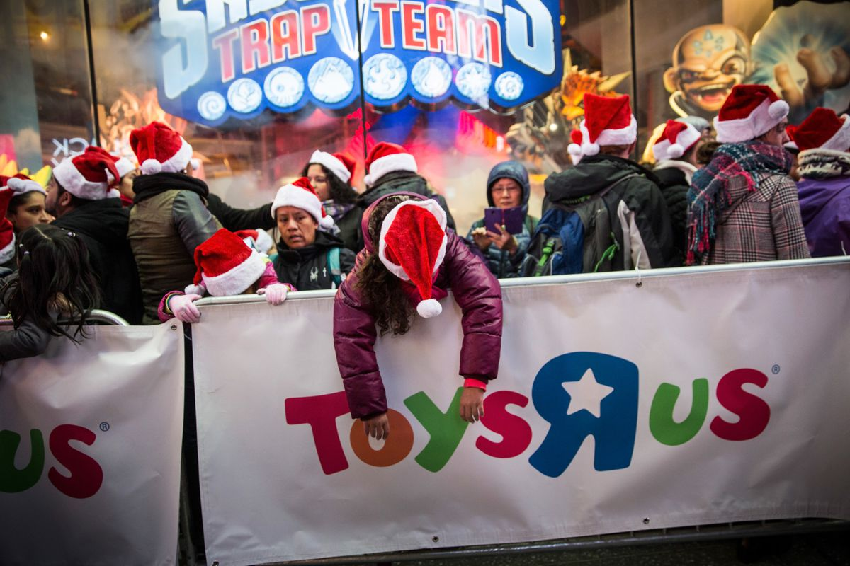 People wait in line to shop at the Toys R Us in Times Square