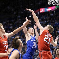 Brigham Young Cougars guard TJ Haws (30) puts up a shot between Utah Utes forward Jayce Johnson (34) and forward Tyler Rawson (21) at the Marriott Center in Provo on Saturday, Dec. 16, 2017.