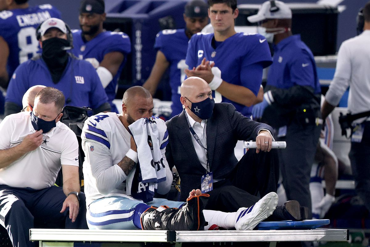 Dak Prescott #4 of the Dallas Cowboys is carted off the field after sustaining a leg injury against the New York Giants during the third quarter at AT&T Stadium on October 11, 2020 in Arlington, Texas.
