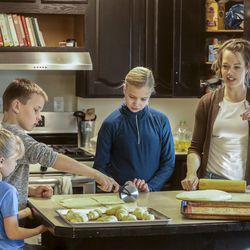 Emily White, right, makes rolls with her children Penny, left, Henry and Ellie in the kitchen of their home in Holladay on Wednesday, Nov. 25, 2020.The family started a bakery two years ago and has been baking loaves of bread every week, fulfilling neighbors' orders. This year, the family is donating proceeds from Thanksgiving roll sales to foster care agency Brighter Futures to help pay for kids' Christmas presents after Utah and Salt Lake counties notified the agency they can't give it funding for gifts this year.