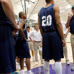 Jazz coach Jerry Sloan, right, works with Jazz hopefuls during a practice Monday, July 12, 2004.