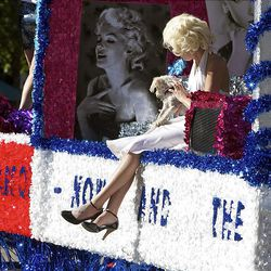 The Humane Society of Utah float goes by with a Marilyn Monroe look a like onboard as spectators watch as the floats, horses and celebrities participate in the Days of '47 Parade in Salt Lake City Saturday.