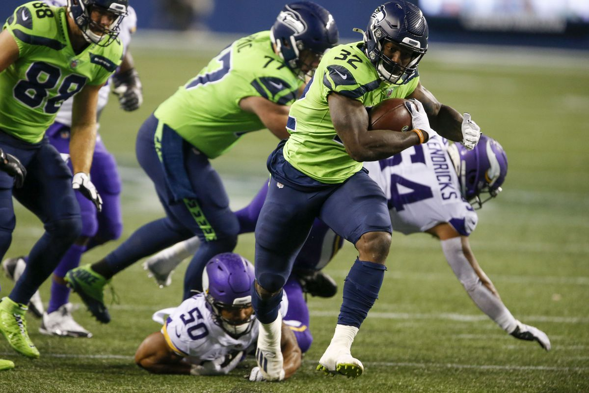 Seattle Seahawks running back Chris Carson (32) rushes for a touchdown against the Minnesota Vikings during the third quarter at CenturyLink Field.