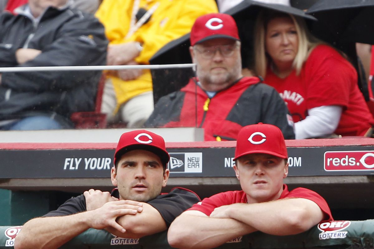 Joey Votto, Jay Bruce, and a spy catch a game.