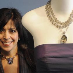 """FILE - In this Dec. 30, 2008 file photo, fashion designer Maria Pinto is seen in her boutique in Chicago. Pinto, famous for dressing first lady Michelle Obama and Oprah Winfrey, used her eye for fashion to curate Field Museum antiquities for a new exhibit that includes a century-old shredded bark Brazilian ceremonial costume and a woven monkey fur necklace. The exhibit  """"Fashion and The Field Museum Collection: Maria Pinto"""" opens Friday, Sept. 14, 2012."""