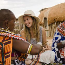 """This undated image provided by PBS shows actress Olivia Wilde in Kenya. Wilde, America Ferrara, and Meg Ryan are among the actresses who brought their star power to the PBS documentary """"Half the Sky,"""" which details efforts to help exploited women worldwide. It airs Monday and Tuesday, Oct. 1-2."""