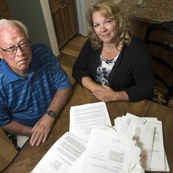 A pile of paperwork regarding a fraud case in which Frank Arnold Horton and his daughter, Suzanne Rengers, were both scammed by their tax preparer and financial manager, clutters the dining room table at Rengers' home in West Jordan on Tuesday, Sept. 27, 2016.