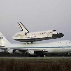 Space shuttle Discovery atop a 747 carrier jet taxi's down the runway before leaving the Kennedy Space Center,  Tuesday, April 17, 2012, in Cape Canaveral, Fla. Discovery is being transported to the Smithsonian National Air and Space Museum in Washington.