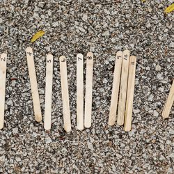 Popsicle sticks used to mark runners finish placement used during the meet at River Park.
