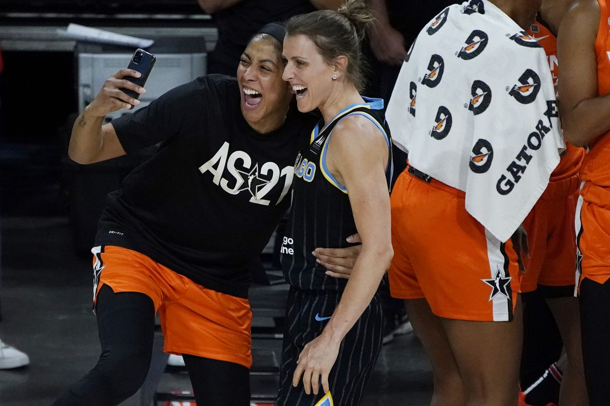 Candace Parker (left) celebrates with Sky teammate Allie Quigley after Quigley won the three-point contest at halftime of the WNBA All-Star Game on Wednesday in Las Vegas.