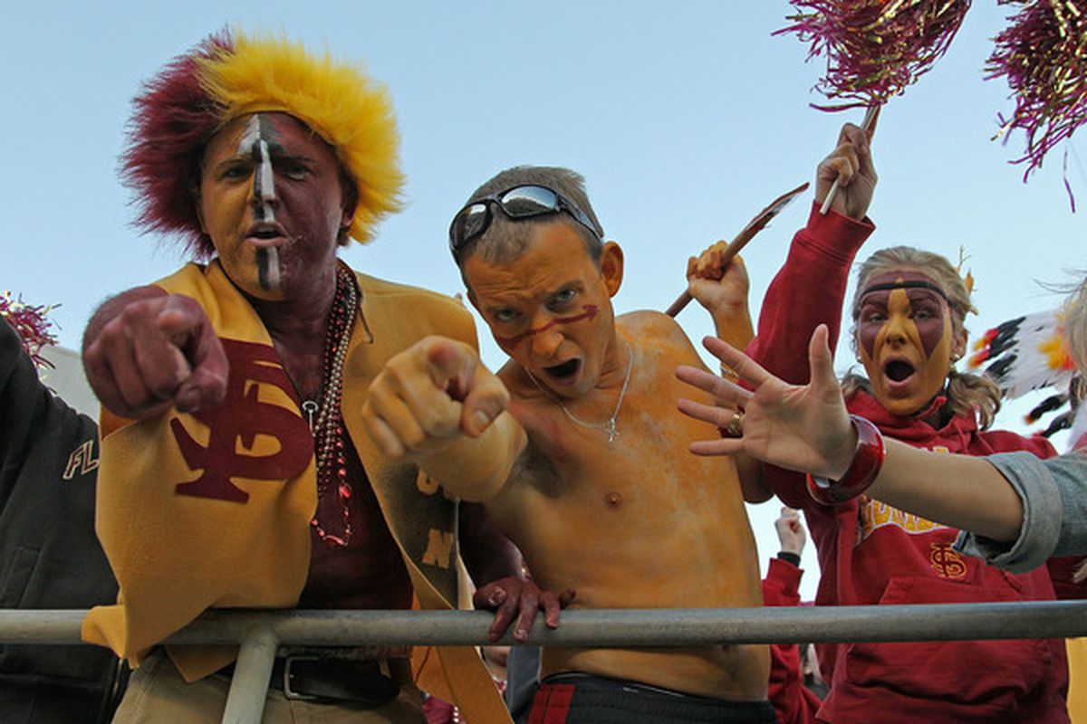 TALLAHASSEE FL - NOVEMBER 27:  Florida State Seminoles fans celebrate after a touchdown during a game against the Florida Gators at Doak Campbell Stadium on November 27 2010 in Tallahassee Florida.  (Photo by Mike Ehrmann/Getty Images)