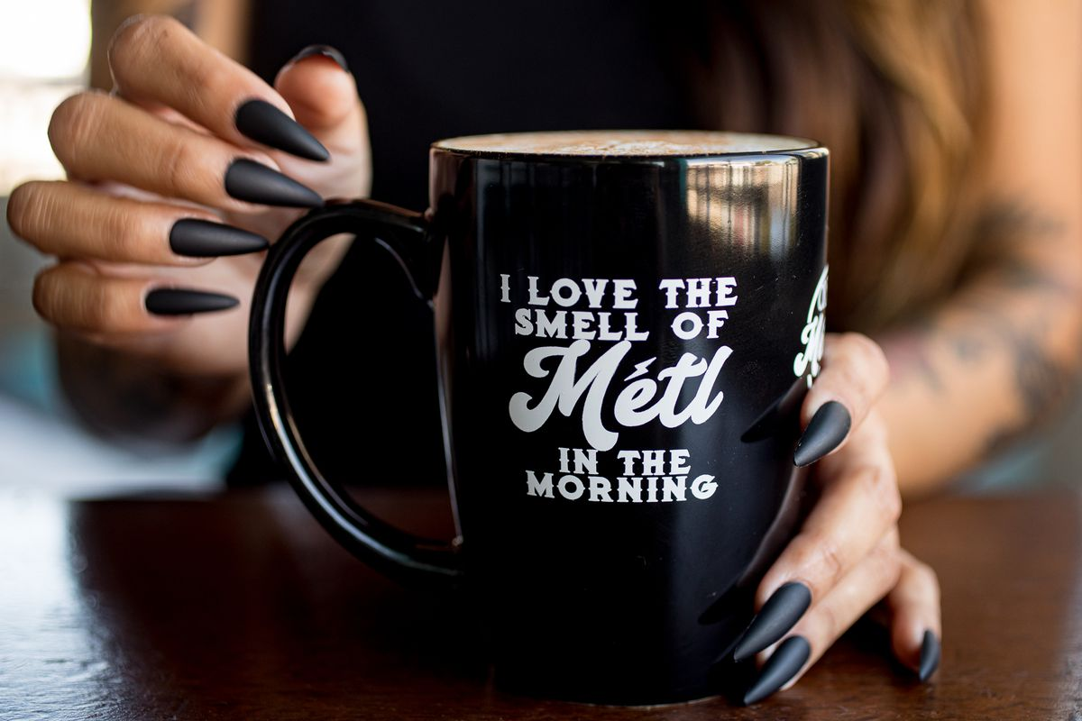 Hands holding a mug from Metl Creamery and Cae