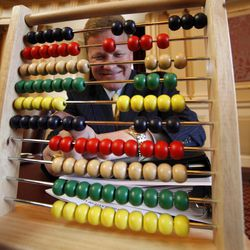 Sen. William M. Stanley, R-Franklin, uses an abacus during the floor session of the Senate at the State Capitol in Richmond, Va., Wednesday, April 18, 2012, as members of the senate work to settle the still unresolved state budget.