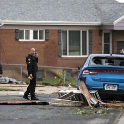 Law enforcement officials assess damage after a tornado struck Washington Terrace on Thursday, Sept. 22, 2016. Officials said nobody was injured in the twister.