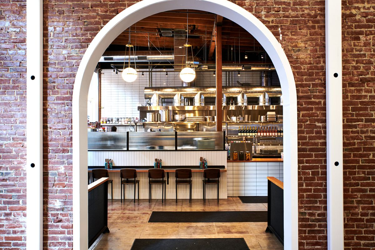 Bae's Chicken's counter has a number of chef's counter seats, which look into a stainless-steel-heavy kitchen