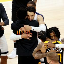 Utah Jazz guard Donovan Mitchell (45) hugs Memphis Grizzlies forward Dillon Brooks (24) at the end of the game as the Utah Jazz defeat the Memphis Grizzlies in game 5 at Vivint Arena in Salt Lake City on Wednesday, June 2, 2021. Utah won 126-110, Utah advances to the second round.