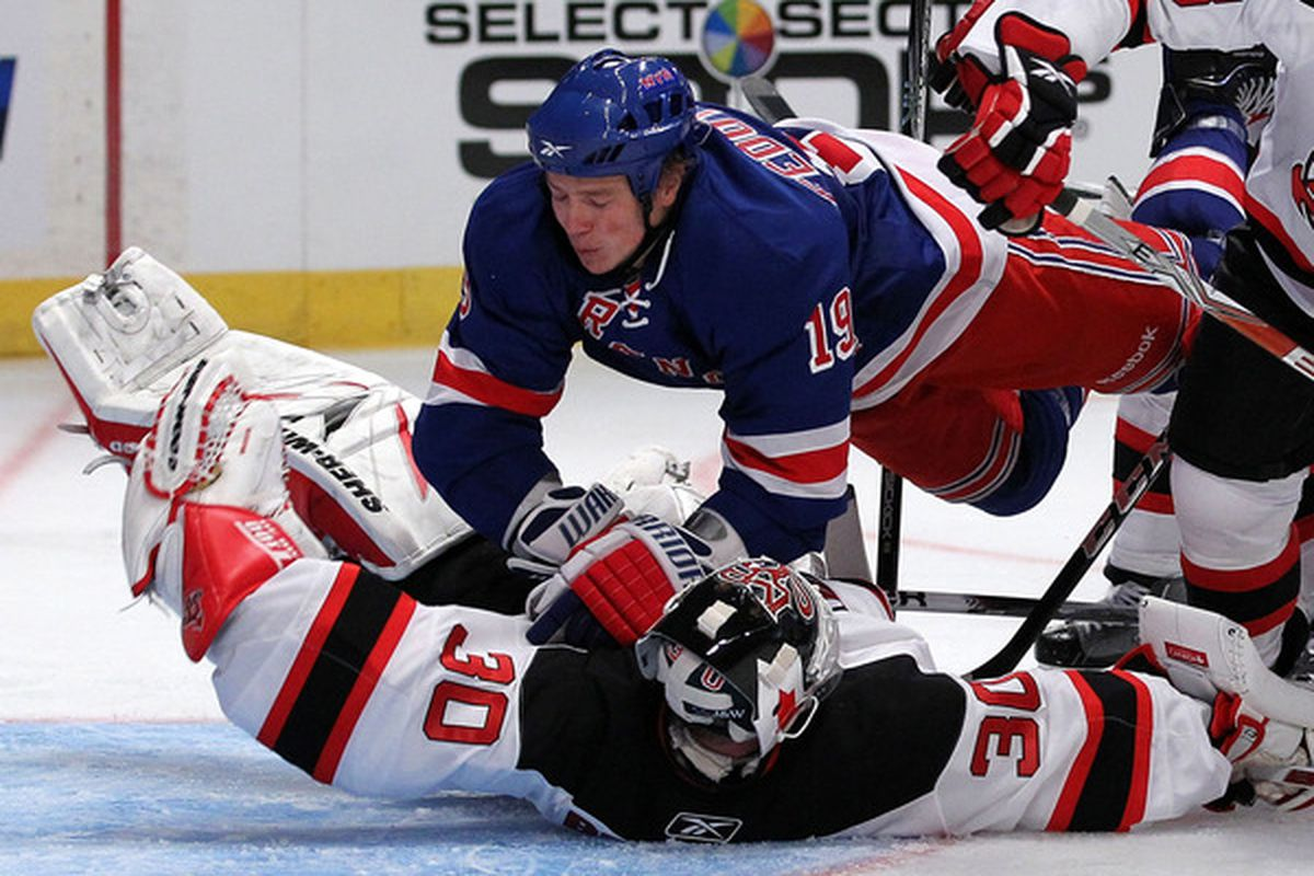 Fedotenko seen here performing CPR on Martin Brodeur.  (Photo by Al Bello/Getty Images)