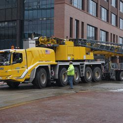 Construction crane getting ready to depart, on Waveland Avenue