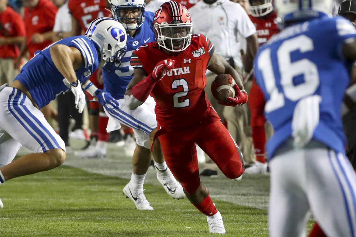 Utah running back Zack Moss (2) heads upfield during the Utah-BYU football game at LaVell Edwards Stadium in Provo on Thursday, Aug. 29, 2019.