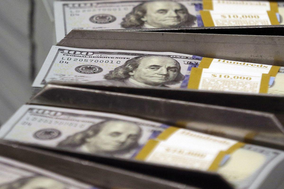 $100 bills being printed.