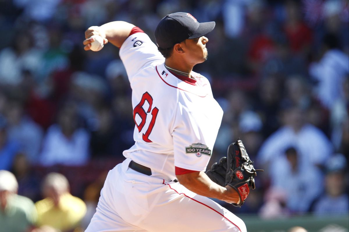 Sep 23, 2012; Boston, MA, USA; Boston Red Sox starting pitcher Felix Doubront (61) pitches against the Baltimore Orioles during the first inning at Fenway Park.  Mandatory Credit: Mark L. Baer-US PRESSWIRE