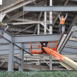 Girder being lowered into the right-center field patio -