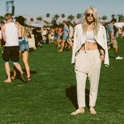 An all-white monochrome Coachella look finished off with cute sandals.