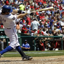 Texas Rangers' Ian Kinsler hits a solo home run against the Chicago White Sox during the third inning of a baseball game, Friday, April 6, 2012, in Arlington, Texas.