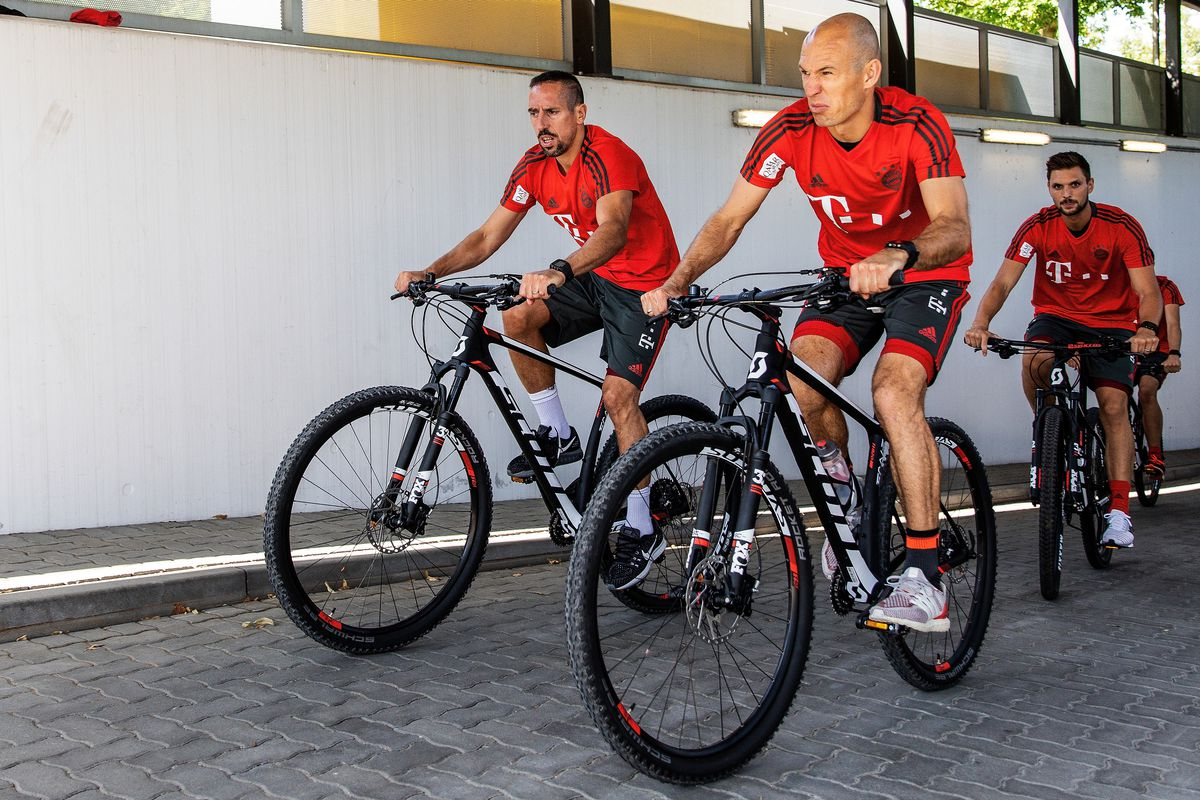 FC Bayern Muenchen Training Session MUNICH, GERMANY - JULY 02: (L-R) Franck Ribery, Arjen Robben and Sven Ulreich of FC Bayern Muenchen are seen on a bike ride on July 2, 2018 in Munich, Germany.