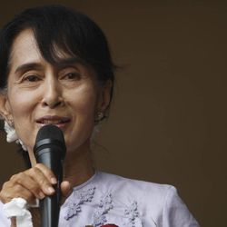 Myanmar's pro-democracy leader Aung San Suu Kyi addresses her supporters and media at the headquarters of her National League for Democracy party Monday, April 2, 2012, in Yangon, Myanmar.  Suu Kyi claimed victory Monday in Myanmar's historic by-election, saying she hoped it would mark the beginning of a new era for the long-repressed country. (AP Photo)
