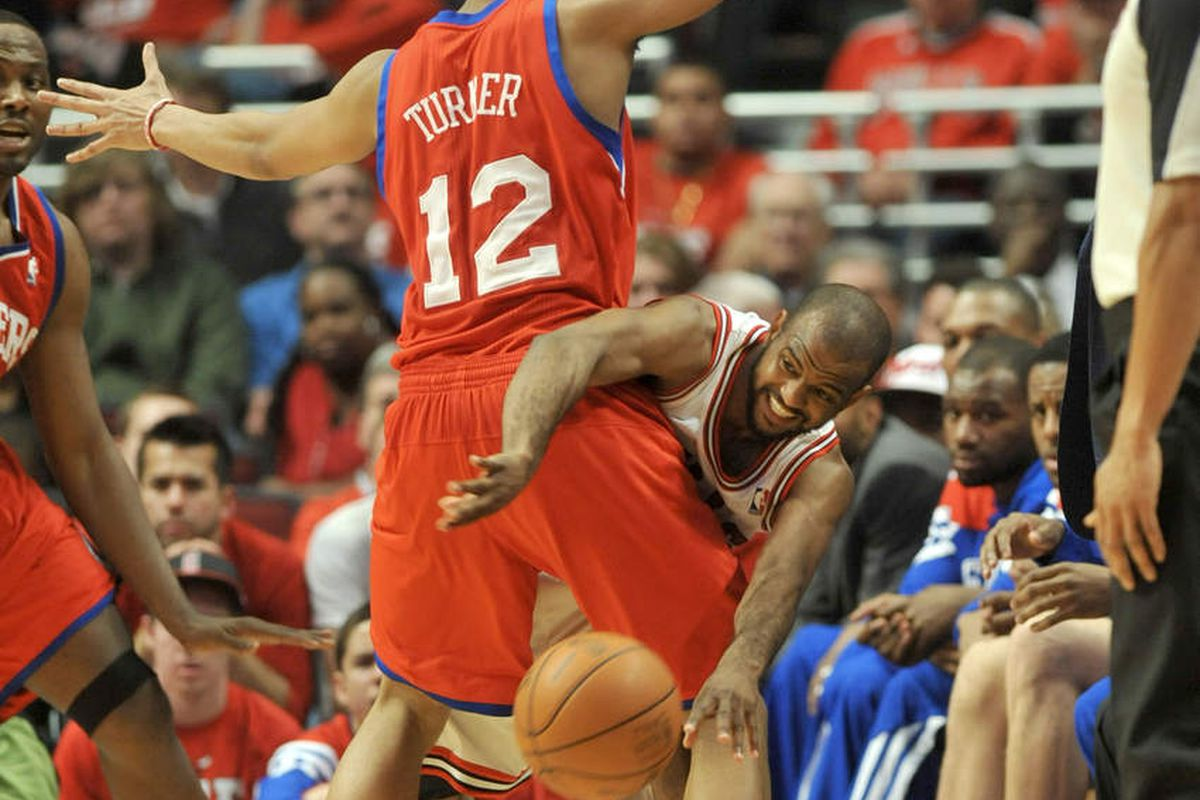 918af74a6948 Bulls guard John Lucas III passes the ball while defended by Sixers guard Evan  Turner in the second half. The Chicago Bulls were defeated 109-92 by the ...