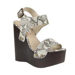 "<a href=""http://www.stevemadden.com/Item.aspx?id=94572&np=708_853""> Steve Madden Ontime wedge shoe</a>, $129.95 stevemadden.com"