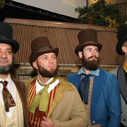 Actors portraying early LDS Church leaders Brigham Young, Wilford Woodruff, Moses Thatcher and Charles C. Rich pose in front of cabin backdrop after performance for Star Valley Wyoming Temple Cultural Celebration.
