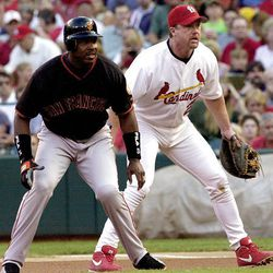 San Francisco Giants' Barry Bonds, left, leads off first base in front of St. Louis Cardinals first baseman Mark McGwire in the first inning of a baseball game in St. Louis in June 2001.