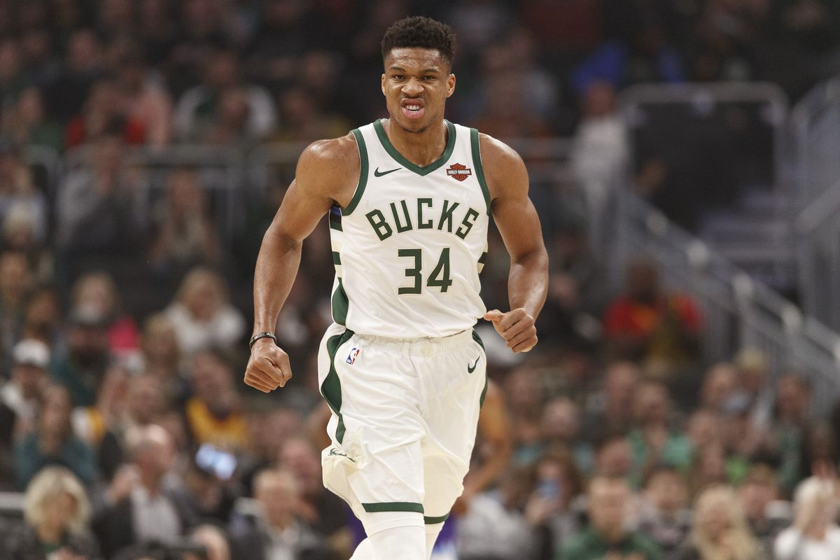 Milwaukee Bucks forward Giannis Antetokounmpo reacts after scoring during the first quarter against the Utah Jazz at Fiserv Forum.