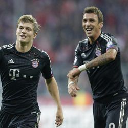 Bayern's Toni Kroos, left, celebrates with team mate Bayern's Mario Mandzukic of Croatia after scoring his side's second goal during the Champions League Group F soccer match between FC Bayern Munich and Valencia CF in Munich, southern Germany, Wednesday, Sept. 19, 2012.