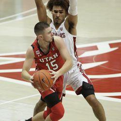 Utah guard Rylan Jones, front, tries to get around Washington State guard Isaac Bonton during the first half of an NCAA college basketball game in Pullman, Wash., Thursday, Jan. 21, 2021.