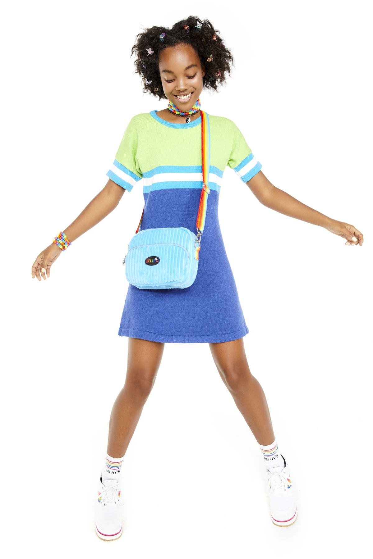 A model wears a blue and green sweater dress.