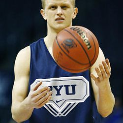 BYU's Tyler Haws tosses a ball as he and the rest of the Cougars practice Wednesday in the Ford Center in Oklahoma City. BYU plays Florida on Thursday in the NCAA first round.