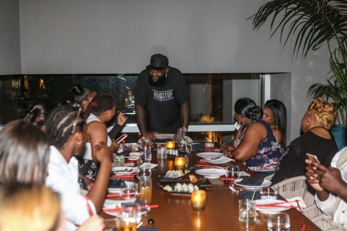 Rick Ross congratulates the staff for all their hard work