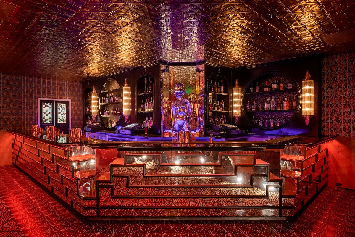 Colorful Art Deco bar counter at Kiss Kiss Bang Bang, Koreatown with purple and red lighting.