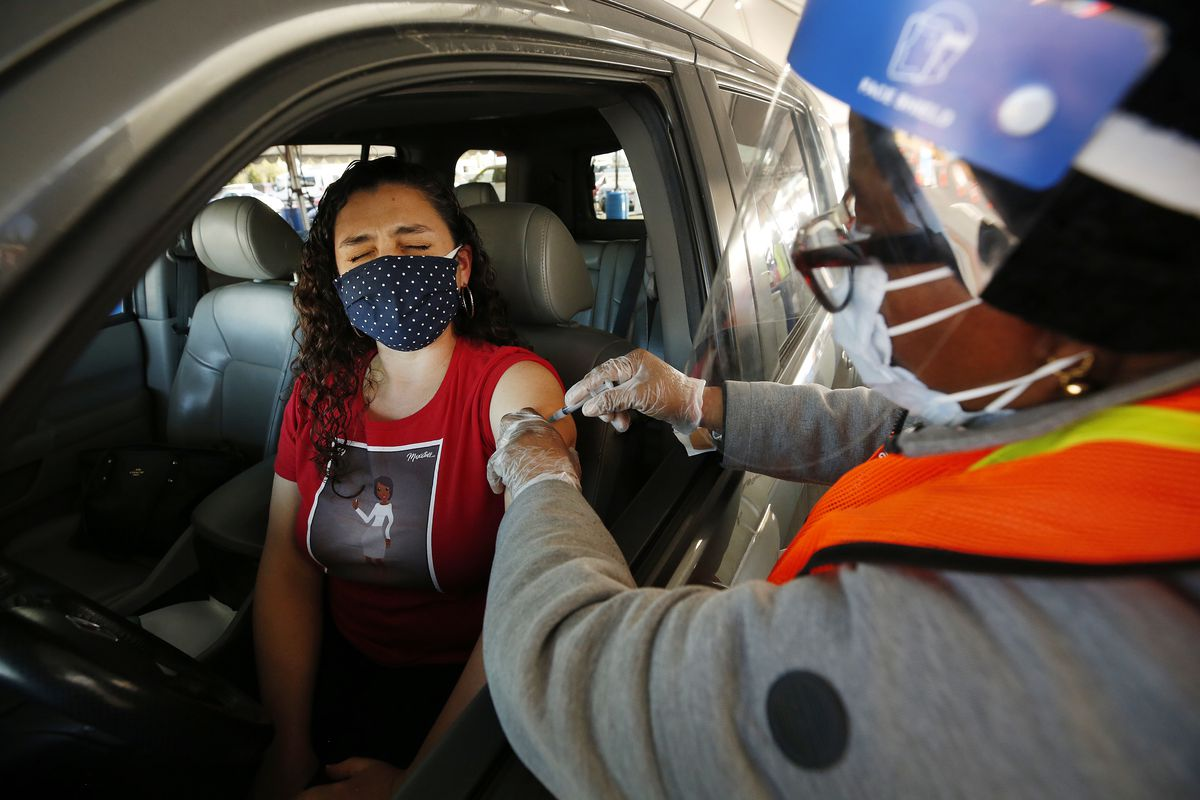 A Los Angeles Unified preschool teacher receives a COVID-19 vaccination shot on March 1, 2021.