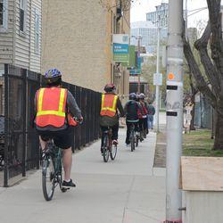 1:53 p.m. Bicycle tour group on Waveland -