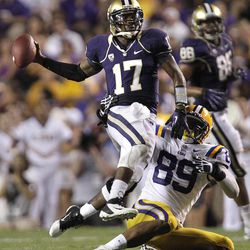 Washington quarterback Keith Price (17) avoids a sack by LSU defensive end Lavar Edwards (89) during the first half of an NCAA college football game in Baton Rouge, La., Saturday, Sept. 8, 2012.