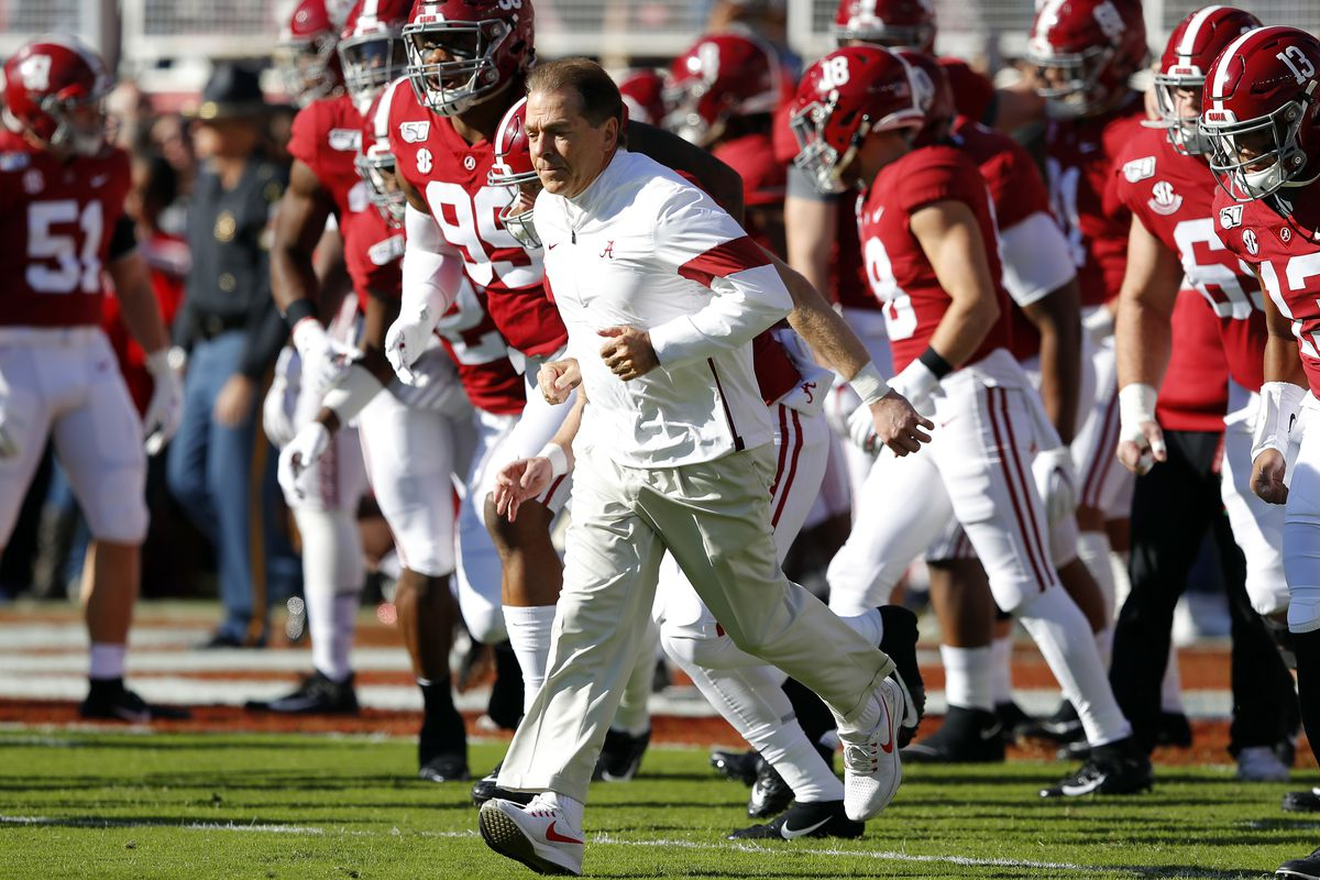 Head coach Nick Saban of the Alabama Crimson Tide runs onto the field before the game against the LSU Tigers at Bryant-Denny Stadium on November 09, 2019 in Tuscaloosa, Alabama.