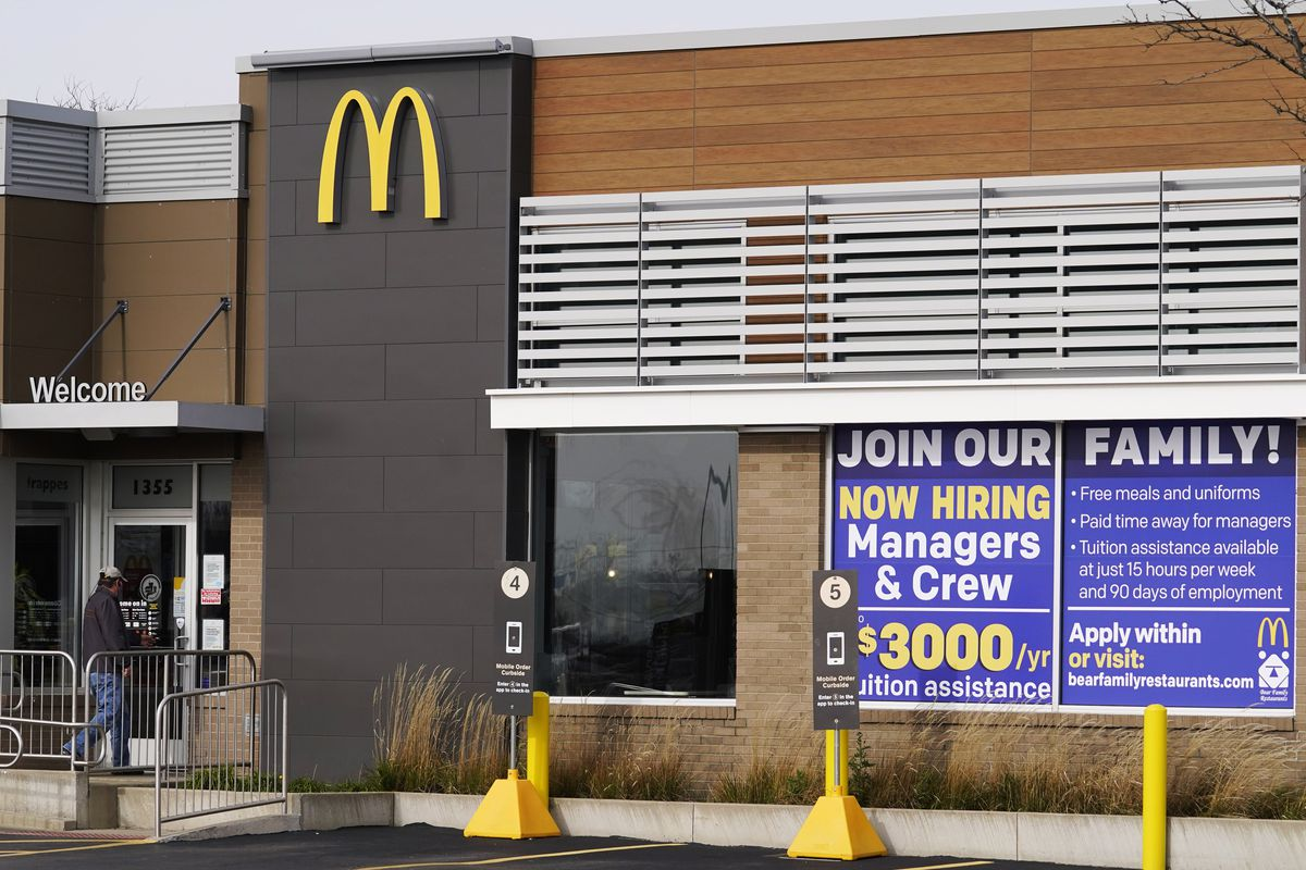 In this Nov. 19, 2020, file photo, a hiring sign is displayed outside of McDonald's in Buffalo Grove, Ill. On Wednesday, April 14, 2021, McDonald's said the company will mandate worker training to combat harassment, discrimination and violence in its restaurants worldwide starting in 2022.