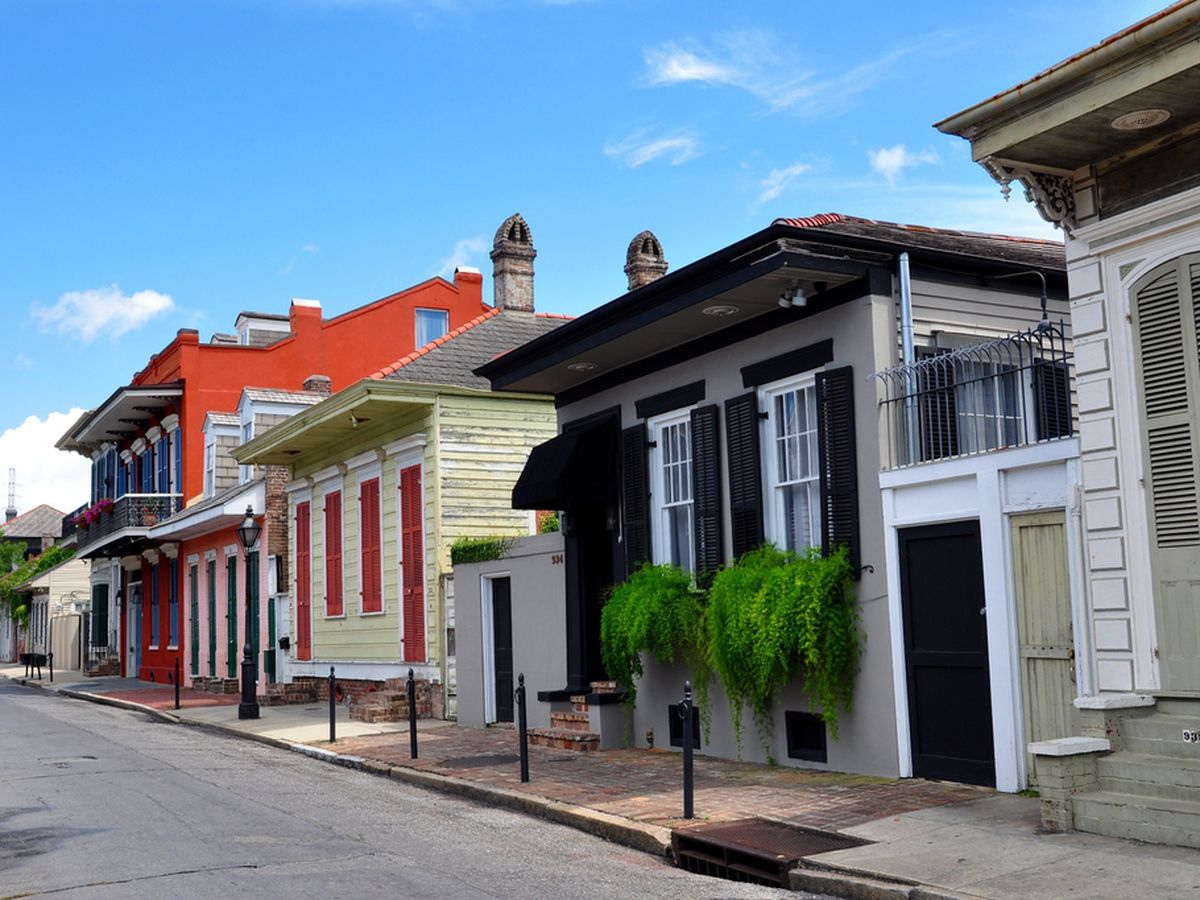 A row of houses on a New Orleans street. Each house is a different color.