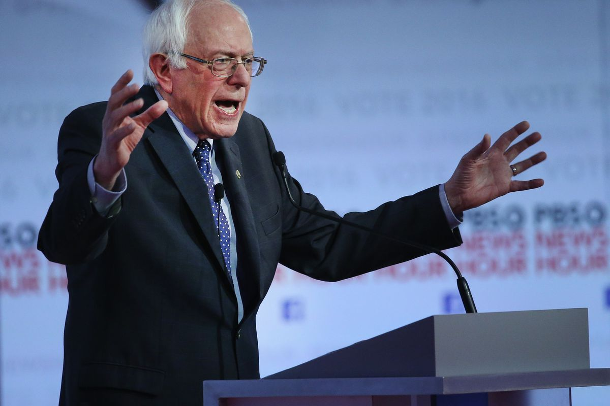 Bernie Sanders at a debate in February. No moderator asked about poverty in nine presidential debates, a new report finds.
