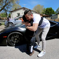 Adrian Zamarripa hugs Jeremy Neves, owner of a Lamborghini Huracan, in Ogden Tuesday, May 5, 2020. Adrian, who is 5, tried to drive his parents' car to California to get his own Lamborghini on Monday, He was stopped by the Utah Highway Patrol just a few miles from his home. Neves went to Adrian's home Tuesday to give him a ride in the car.